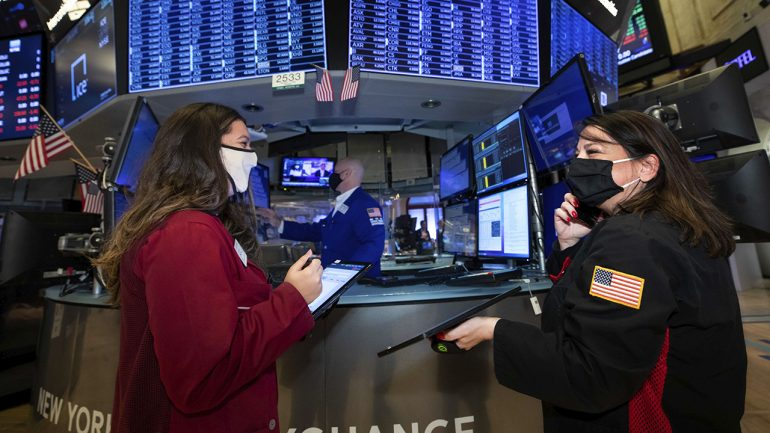 Equity futures trade cautiously higher after a choppy Monday session