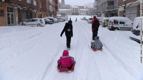 Children play in the snow during heavy snowfall Filomena in Mazan, Spain.