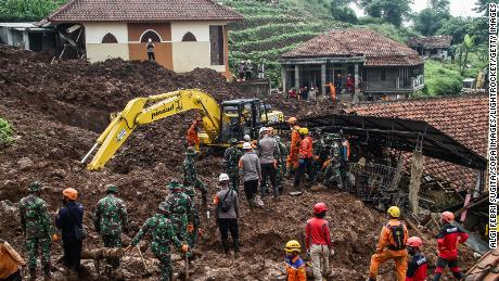 Rescue teams search for victims buried by landslides in Cihanjuang Village, West Java.