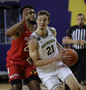 Michigan Wolverines Franz Wagoner (21) leads Maryland Terrapins striker Donta Scott (24) during the first half on Tuesday 19 January 2021 in Ann Arbor.