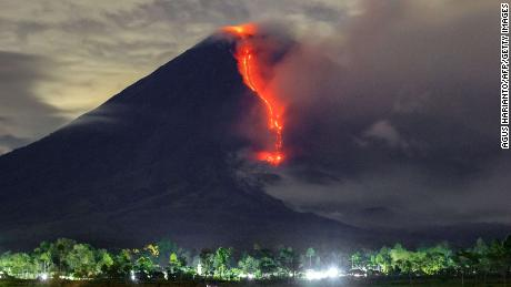 In this photo taken on January 16, 2021, lava is seen during an eruption of Mount Semeru volcano in Lumagang, East Java.