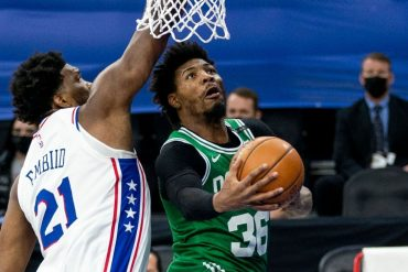 "Joel Embiid of the Philadelphia 76ers mocks Marcus Smart's claim that he is ""holding back"" calls"