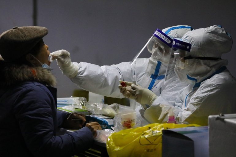 More parts of China were locked down as virus cases soared ahead of the WHO visit
