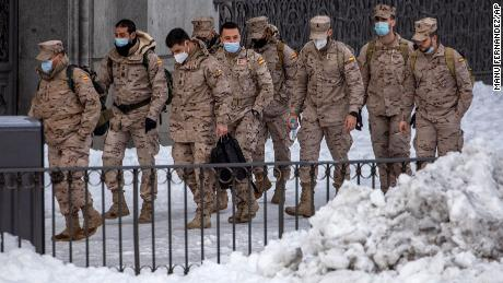 Members of the military walk through the snow in central Madrid, Spain, Sunday, January 10.