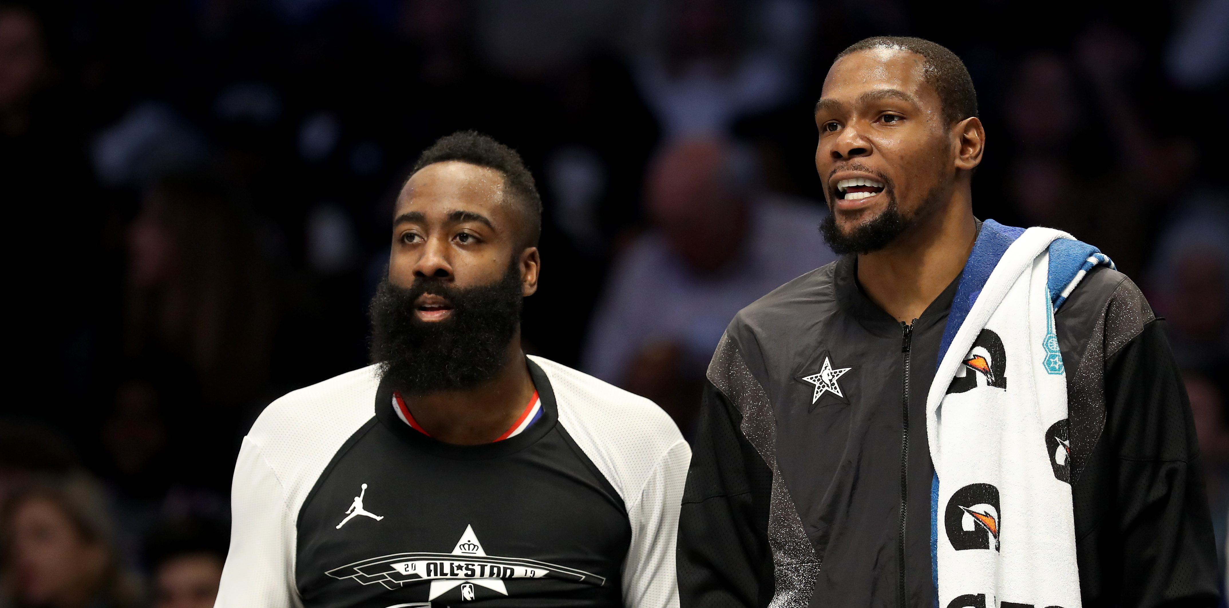 CHARLOTT, North Carolina - February 17: James Harden No. 13 of the Houston Rockets, teammate Kevin Durant No. 35 of the Golden State Warriors and Team LeBron watch from the bench during the NBA All-Star Game as part of the 2019 NBA League 2019. Star Weekend At the Spectrum Center on February 17, 2019 in Charlotte, North Carolina.  Note to the user: The user expressly acknowledges and agrees, by downloading and / or using this image, that the user accepts the terms and conditions of the Getty Images License Agreement.